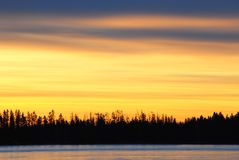 Sunset on the ice lake Royalty Free Stock Images