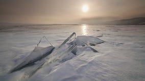 Sunset on the ice of Lake Baikal. Timelapse stock footage