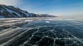 Sunset on the ice of Lake Baikal. Timelapse stock video