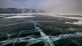 Sunset on the ice of Lake Baikal. Timelapse stock video footage
