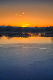 Sunset on iced water Stock Photo