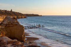 Sunset at the iconic Port Willunga Jetty ruins looking down from. The cliff face in South Australia on 22nd September 2018 stock photo