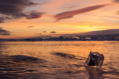 Sunset in the icy Lake Baikal, Irkutsk region, Russia Royalty Free Stock Images