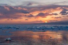 Sunset in the icy Lake Baikal, Irkutsk region, Russia Stock Photo