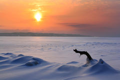 Sunset in the icy wilderness Stock Images