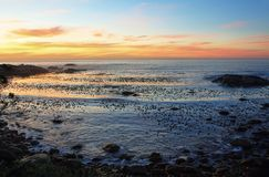 Sunset in idyllic beach near Camps bay Stock Images