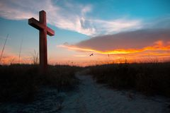 Sunset illuminating a cross. In this new year full of challenges and opportunities a looking at the cross can make a difference stock images