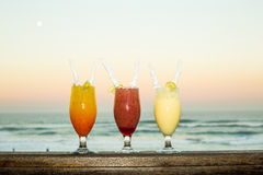 A sunset image showing mixed drinks lined up Stock Photo