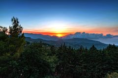 Free Sunset In The Mountains With The Haze Of The Sea Stock Photo - 157023970