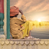 Sunset in India. Holy man on a window looking at the sunset in India Stock Photos