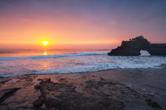 Sunset Indonesian temple in sea Tanah lot complex. Bali. Indonesia Stock Photos