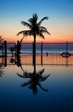 Sunset and infinity pool Stock Photography