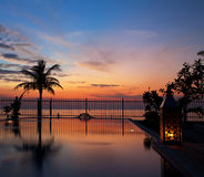 Sunset and infinity pool stock photo
