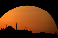 Sunset at Instanbul. Orange sunset at Istanbul with mosque Stock Image