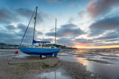 Sunset at Instow in Devon. Sunset over a sailing boat moored at Instow on the north coast of Devon stock photography