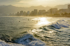 Sunset on Ipanema beach. In Rio de Janeiro with the Leblon beach and Rio de Janeiro hills in the background Royalty Free Stock Photography