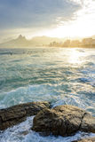 Sunset on Ipanema beach in Rio de Janeiro. With the Leblon beach and Two Brothers hill and Gavea stone in background Stock Image