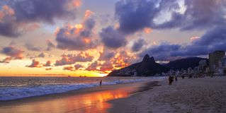 Sunset on the Ipanema. Water, mountain and sky. royalty free stock photography