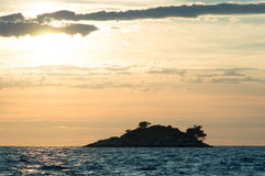 sunset with an island Stock Image