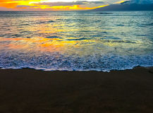 Sunset on island black sand beach Royalty Free Stock Photography