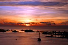 Sunset island and boat. Location: losari beach Makassar Indonesia stock images