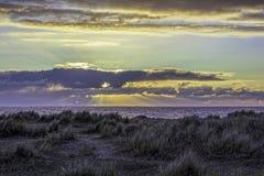 Sunset on the island horizon Stock Photos