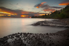 Sunset in the caribbean. Sunset on the island of Martinique taken with long exposure to soften the ocean Royalty Free Stock Photo