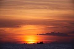 Sunset on island. Sunset in Thailand with boat on horizon Stock Photo