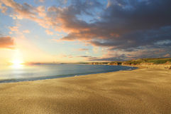 Sunset on an isolated beach Royalty Free Stock Photo