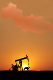 Sunset on isolated oil fields with silhouette Stock Photos
