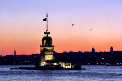 Sunset in Istanbul. Leanders Tower on front of Istanbul silouette Royalty Free Stock Photography