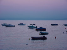 Sunset in Italy. Boats on Garda lake in Italy Royalty Free Stock Photo