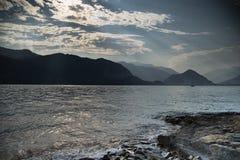 Sunset on Italy lake Stock Images