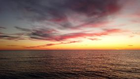 Sunset in its golden hour. With clouds and calm sea water stock footage