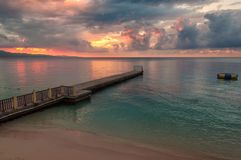 Sunset at Jamaica beach and pier. Sunset view on beautiful Caribbean beach and pier in Montego Bay, Jamaica island Stock Image