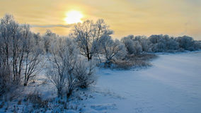 Sunset in January over the river. Covered with ice Royalty Free Stock Images