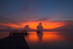 Sunset at the jetty. Sunset on a jetty in the Togian Islands (Indonesia Stock Photography