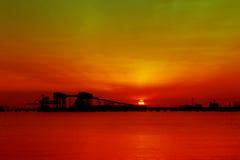 Sunset through jetty Stock Photography