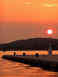 Sunset jetty. The sun setting over a jetty, Croatian Pula Stock Photo