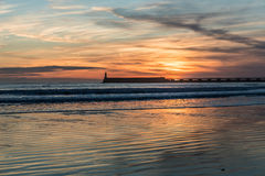 Sunset on the jetty of Les Sables d`Olonne Royalty Free Stock Photos