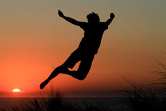 Sunset jump Stock Photography
