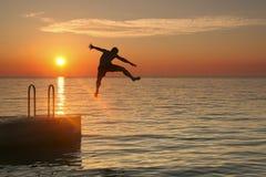 Sunset Jump Stock Photography