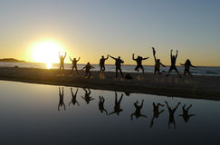 Sunset jump at Stradbroke Island. Stradbroke Island in Brisbane, Australia. Sunset with many people jumping Stock Photography