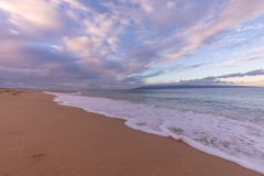 Sunset on Kaanapali Beach. A beautiful sunset along Kaanapali beach on the island of Maui royalty free stock image