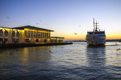 Sunset at Kadikoy. Passenger ferry arriving to the Kadikoy port at evening time Royalty Free Stock Photo