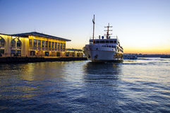 Sunset at Kadikoy. Passenger ferry arriving to the Kadikoy port at evening time Stock Photography