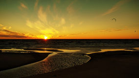 Sunset and kaitboard on sea coast Stock Image