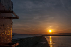 Sunset at Kalamata. Port, Greece as seen from the port`s lighthouse Royalty Free Stock Photos