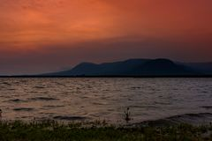 Sunset in Kampot, sea coast with mountains in the background Stock Photography