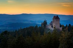 Sunset in Kasperk castle, Sumava, Czech Republic. Cold day in Sumava National park, hills and villages in the fog and rime, misty. Evening stock photos